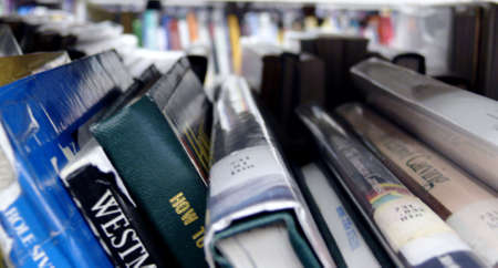 books on a shelf in a public library, close-up