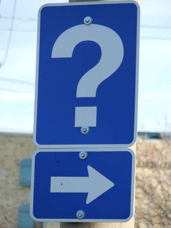 a street sign with a question mark