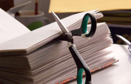 reusing: scissors cutting the pages of an agenda Stock Photo