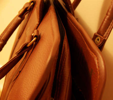 accesory: detail of an old-fashioned leather bag Stock Photo