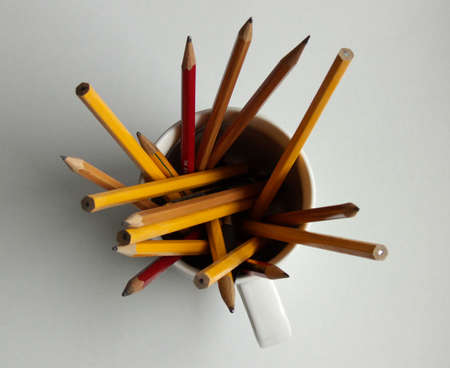 seen: a cup filled with pencils seen from above