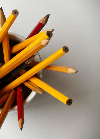 a cup filled with pencils seen from above