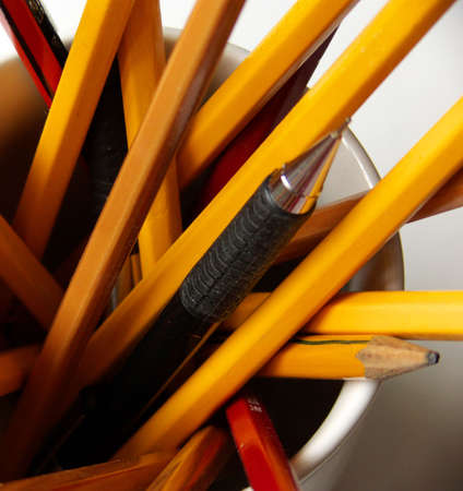 close-up on a cup filled with pencils Stock Photo