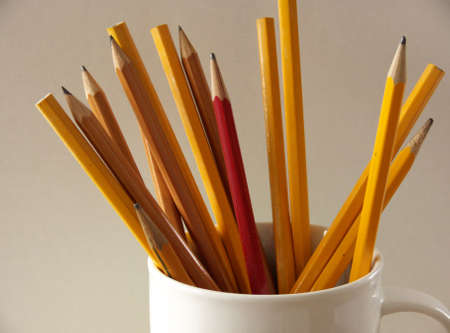 cup filled with pencils