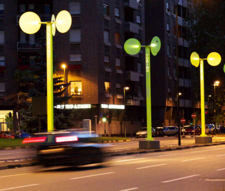 a street of torino, italy, by night; the picture shows some of the modern decorations installed in 2006 when torino hosted the winter sports competitions