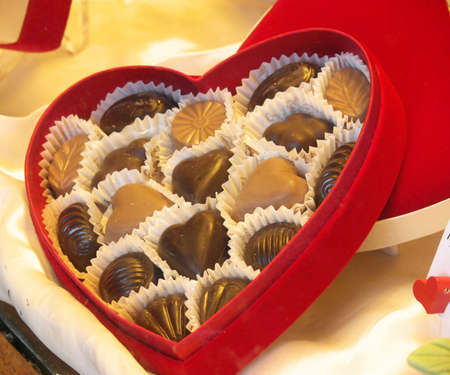 chocolates in a heart shaped red box