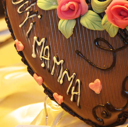detail of a chocolate heart decorated for mothers day