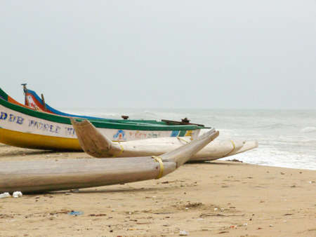 fishermens boats on the beach of madras in south india