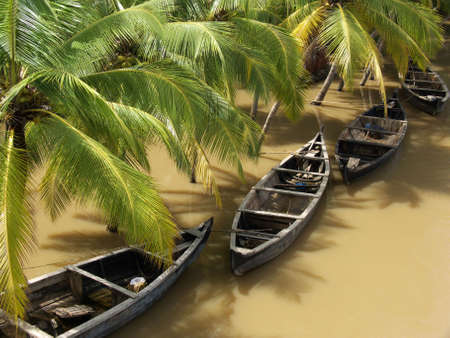 boats on a river in kerala, south india, during the rainy season Stock Photo