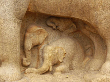 detail of engravings at mahabalipuram, tamil nadu, south india: small elephants resting in the shadow of a big elephant