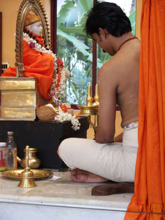 puja: hindu priest conducting a puja in an indian temple Stock Photo