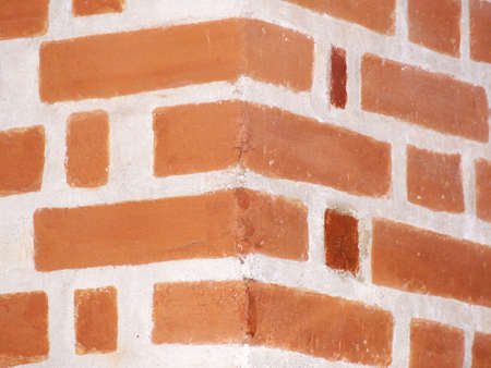 corner of a wall with exposed bricks
