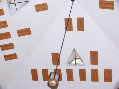 lamp hanging from pyramidal ceiling Stock Photo