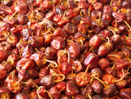 dried red chilli peppers in an indian street market close-up
