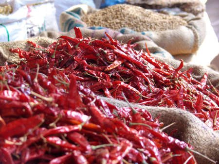 Bags of chillis and lentils in an indian street market close-up