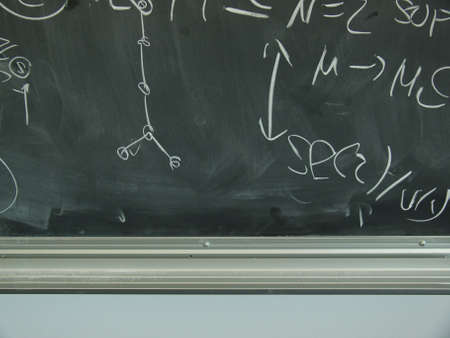 computations: lower edge of blackboard with formulae Stock Photo