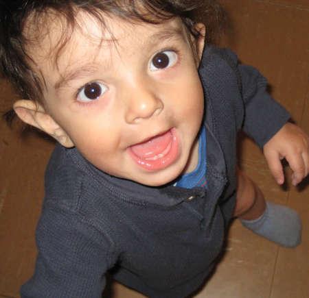 happy  boy looking up at the camera Stock Photo
