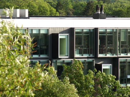 modern building surrounded by vegetation Stock Photo