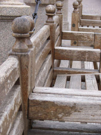 Close-up on a row of wooden benches