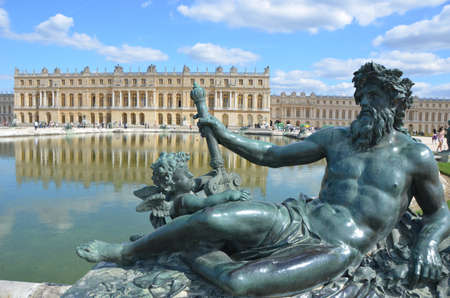 Sculptures and pond in front of the Royal residence at Versailles near Paris in France photo