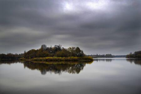 Gloomy river island Standard-Bild