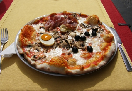 Italian pizza served in restaurant