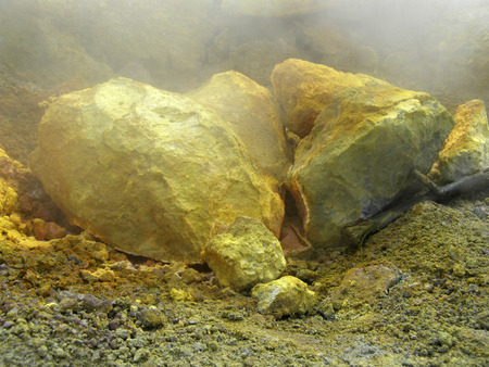 fumarole: Volcanic fumarole with sulphur and arsenic deposits Stock Photo