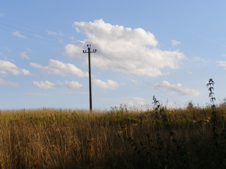 mast: Electricity power mast in field Stock Photo
