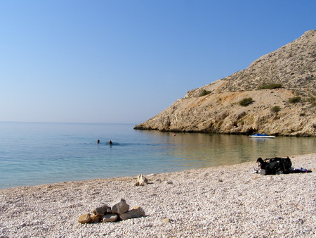 secluded: Secluded empty pebble beach in Croatia Stock Photo