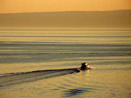 motorboat: Motorboat in sea at sunset Stock Photo