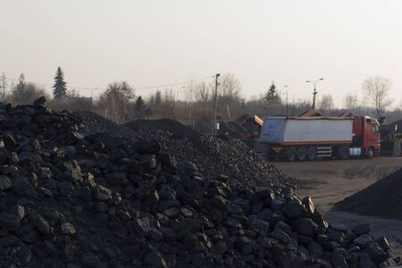 coal truck: Heap of black coal with truck