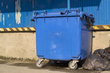 blue bin: Blue garbage bin