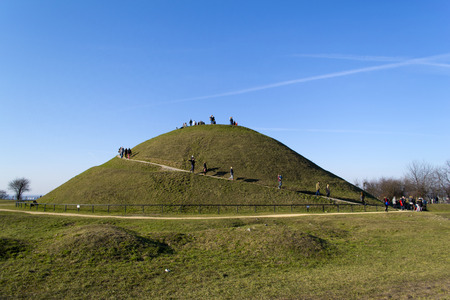 Green mound with footpath to top photo