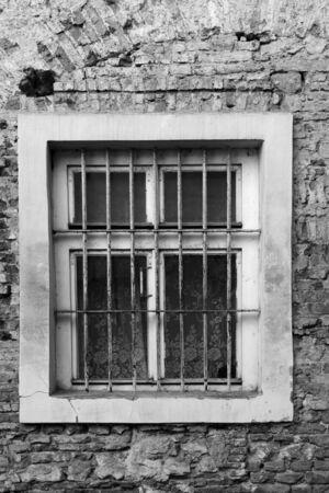 window bars: Old window with metal bars