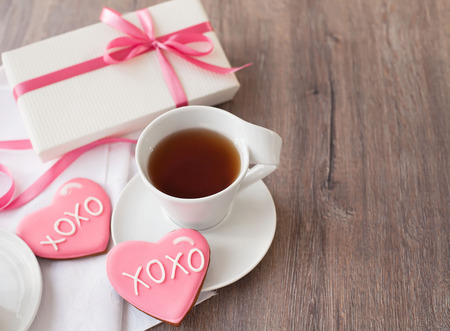 Heart shaped cookies, present box and a cup of tea Banco de Imagens