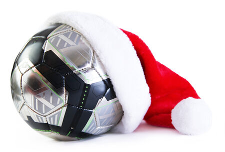 santa clause hat: football with santa clause hat on isolated white