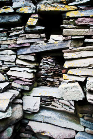 piled: Detail of an ancient wall made by piled stones without mortar
