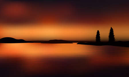 Beautiful golden sunset over the ocean with distant land and silhouette of two fir trees. Reflections on the water surface.