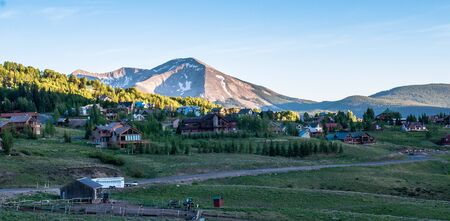 Mt Crested Butte with homes and cabins in the foreground