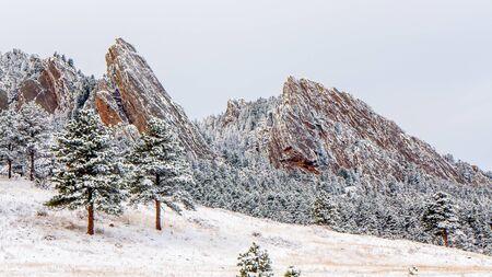 Colorados Boulder Flatirons after a snowfall