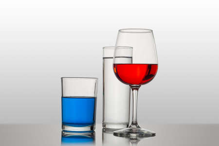 Glasses with colored drinks, with attractive compositions
