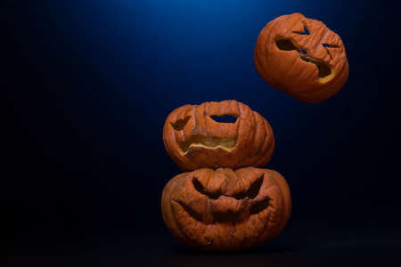 Halloween pumpkins with terrifying expressions and lights background