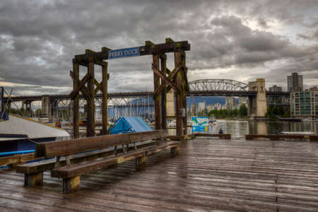 boat dock: Boat Dock in Granville Island, in Downtown Vancouver, BC, Canada. Taken on a cloudy morning. Stock Photo