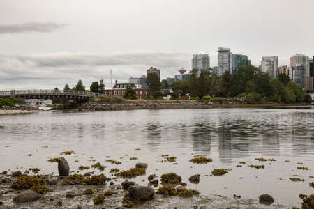 seawall: Vancouer Downtown viewed from Seawall at Stanley Park on a cloudy evening before sunset.