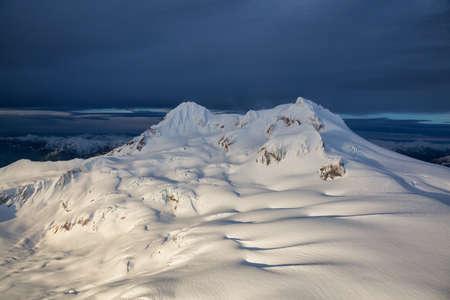 Aerial Landscape view of Garibaldi Mountain during a winter sunrise. Picture taken near Squamish, British Columbia, Canada.