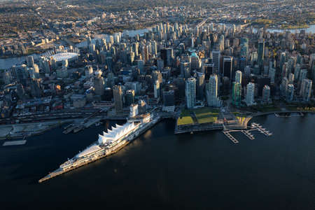 Beautiful Aerial View of Vancouver Downtown, British Columbia, Canada, during a bright spring sunset. Stock Photo