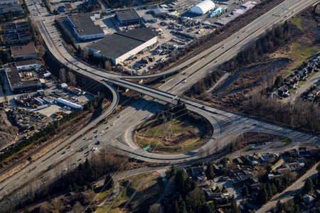 Aerial view of the over pass bridge at Lougheed Hwy and United Blvd. Picture taken in Coquitlam, Greater Vancouver, BC, Canada.
