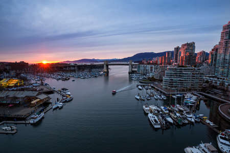 False Creek in Downtown Vancouver, British Columbia, Canada. Taken from an aerial perspective during a colorful sunset.