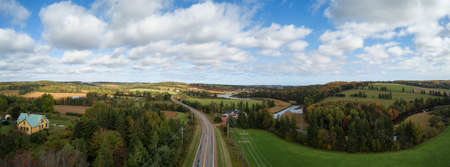 Aerial panoramic landscape view of Farm Fields during a sunny day. Taken near New Glasgow, Prince Edward Island, Canada. Stock Photo