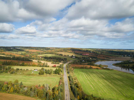 Aerial panoramic landscape view of Farm Fields during a sunny day. Taken near New Glasgow, Prince Edward Island, Canada. Banco de Imagens